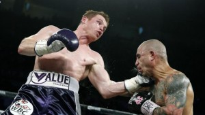 canelo landing a punch against cot to