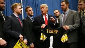 trump with iowa hawkeye football players