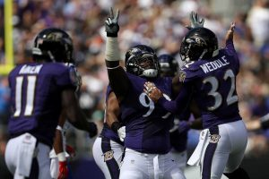 eric weddle celebrates with timmy jernigan