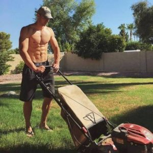 sexy guy mowing the lawn