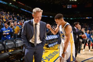 steve kerr and steph curry share a laugh