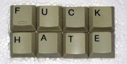 """keyboard keys on a styrofoam background; the keys spell out """"FUCK HATE"""""""