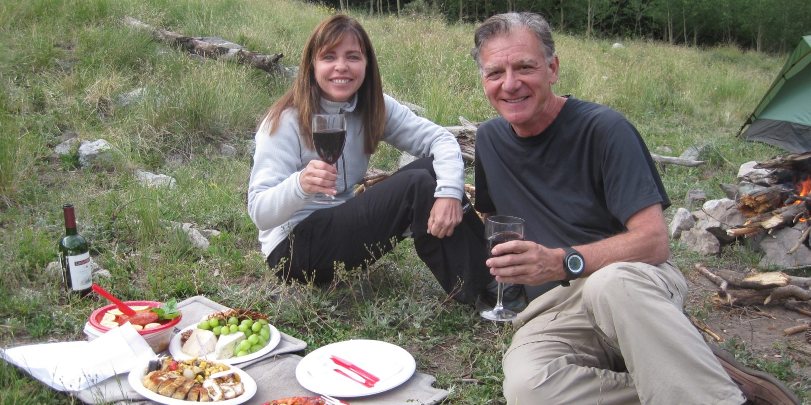 Rick Crandall and Laura Welch enjoying a gourmet outdoor meal