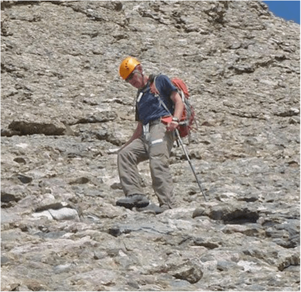 Rick Crandall descending a trail using the cross-over step