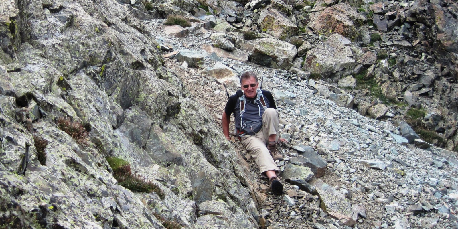 Photograph of Rick Crandall slipping on loose rocks