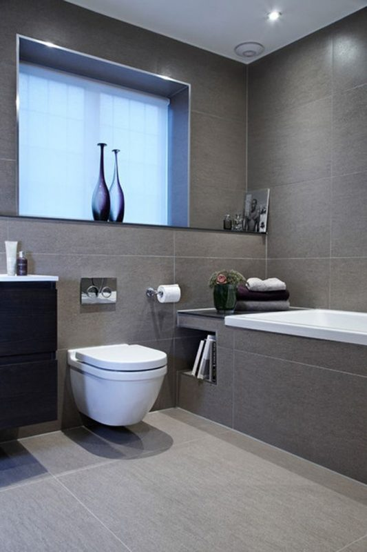 Grey bathroom ideas with a sleek tub design