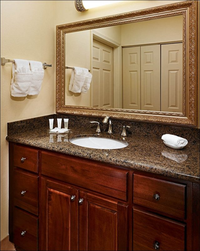 brown laminate bathroom vanity with tops
