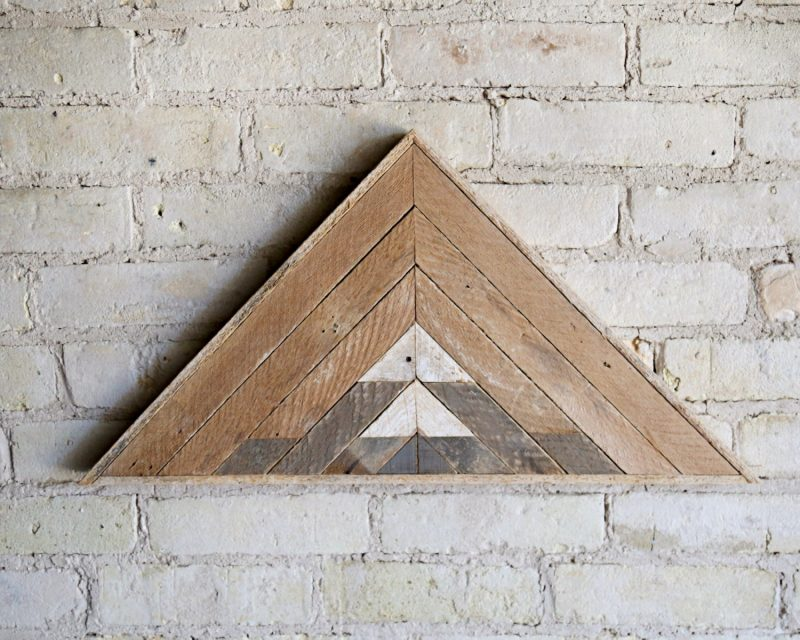 rustic wall decor above fireplace