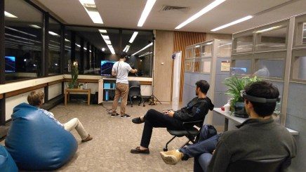 Student using the VIVE while three others watch