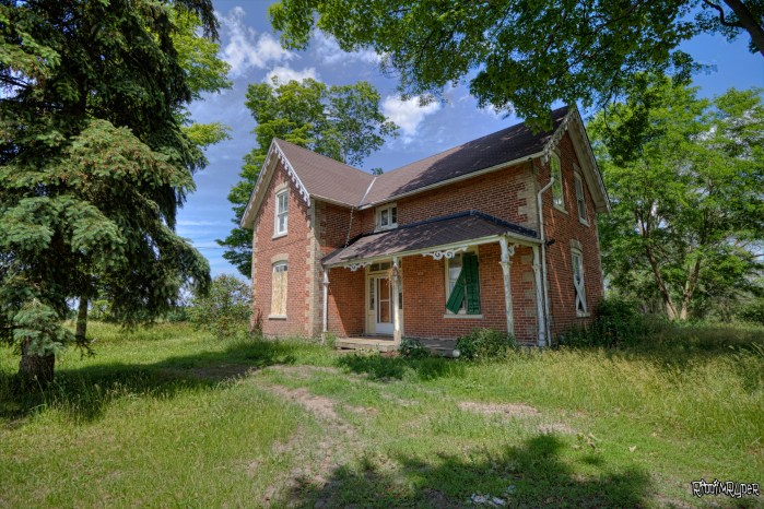 Abandoned Red Brick Homestead