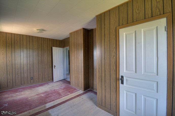 Room with wood paneling