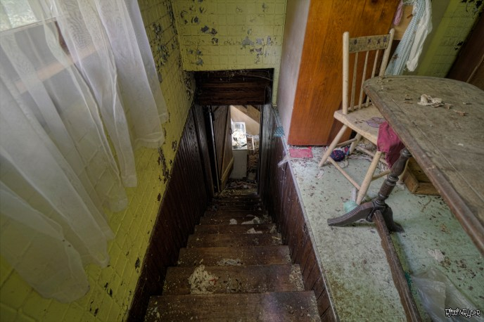 Down the stairs of the abandoned country retreat