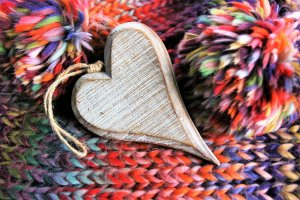 Colourful yarn scarf and pompoms with heart ornament for Hooks n' Books group