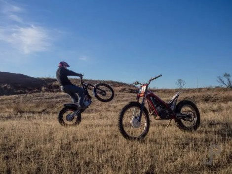Chris Johnson rides a wheelie past his class motorcycle. There is plenty of room to practice at their ranch west of Lawton.