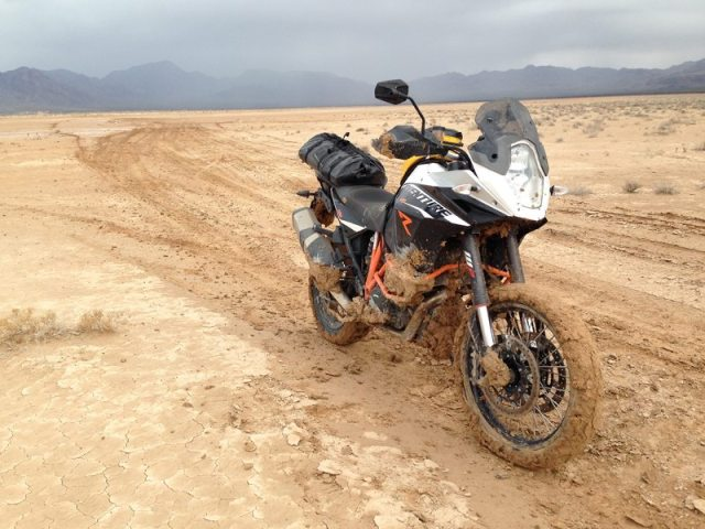 Thick, cakey mud proved to be too much for the KTM 1190 Adventure R's front fender. (Photo by Greg Drevenstedt)