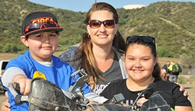 Ride for Kids Star Izaiah with his mother, Ami, and sister, Jade, at the SoCal event. (Photo: Ride for Kids)