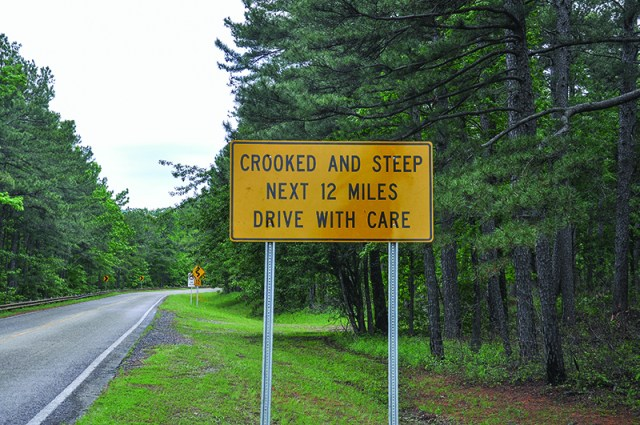 The approach to Talimena Scenic Byway on the Arkansas end. The sign says it all. Get ready to roll!