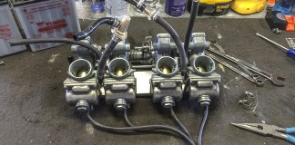 Slide-throttle carbs like these are generally easier to rebuild than CV models that have more parts.