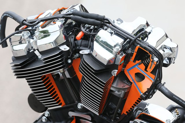 Cut-away of the Milwaukee-Eight 107 shows passages for precision oil-cooled cylinder heads (in blue) and anti-knock sensors on the inside of each cylinder.