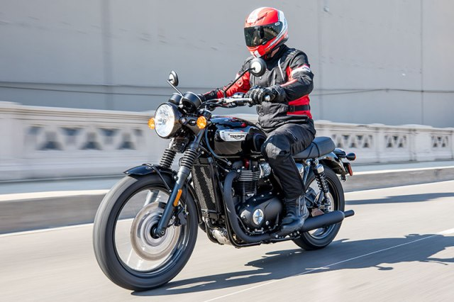 "The new-for-2017 Triumph Bonneville T100 Black is a ""mini me"" of the T120, with similar styling but a smaller, 900cc engine. (Photos by James Martinec, the author and courtesy Triumph)"