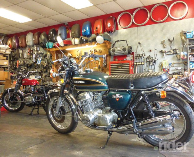 The Honda's Freedom Green Metallic paint pops against the shop's backdrop of classic bikes, tanks and tools. When they're running well, 1970s Hondas still make great daily riders.