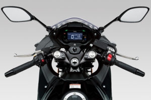 Behind the Suzuki GSX250R's small windscreen is a reverse-lit LCD instrument panel.