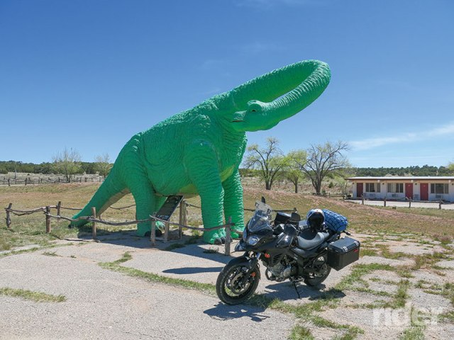 A dinosaur is a good way to catch the tourist's eye as the  road approaches the Grand Canyon Caverns on old U.S. 66 west of Seligman, Arizona; an elevator will take you down 21 stories.