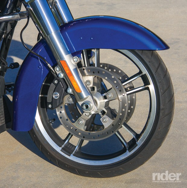 A low-profile fender wraps around a 19-inch Enforcer cast wheel. Reflex Linked Brakes with ABS are optional.