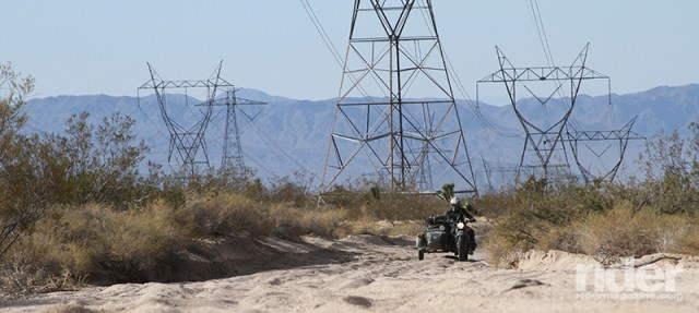Dual-sport or adventure riding in the southwestern United States requires basic sand riding experience at minimum, as even major power line roads like this one can have sandy surprises waiting just over the next rise.