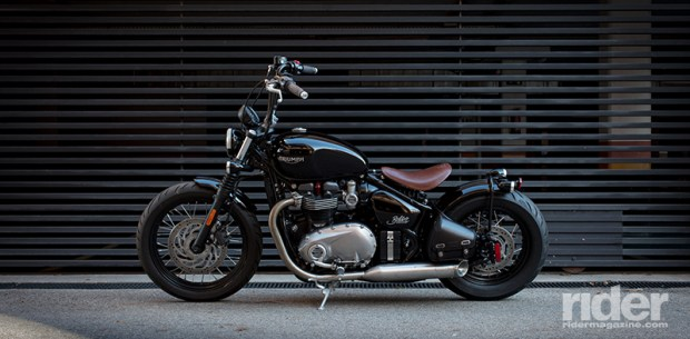 "Triumph will offer two ""Inspiration Kits"" for the Bobber, meant to provide a turnkey custom solution. This one is called the Old School, and includes ape hangers and a brown leather seat."