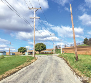 In reality, the road veers left while the telephone lines shoot off on a different path.