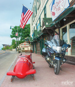 This bobsled sits right on a village sidewalk…hop in!
