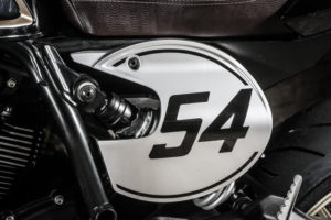 The number plate on the left side has a cut-out to allow access to the preload adjustment on the rear shock.