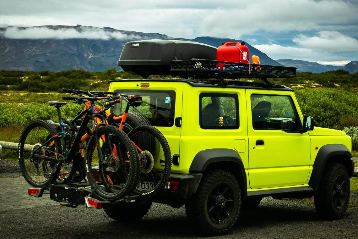 A hitch rack with mountain bikes loaded on.