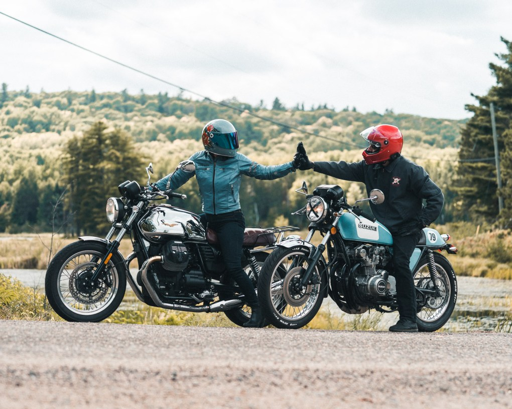 Two riders high fiving