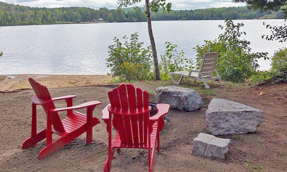 Muskoka Chairs by a lake