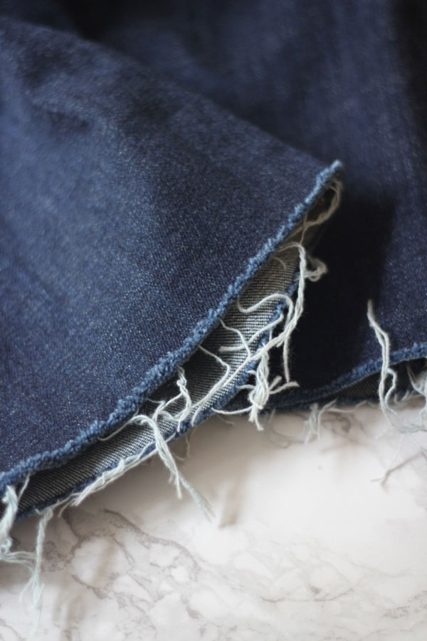 Ridgely Brode gives step-by-step instructions on how to fray your jeans at home on her blog Ridgely's Radar