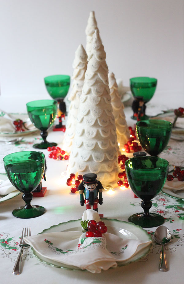 Ridgely Brode, Lifestyle Blogger, sets her table for Christmas with a vintage table cloth and napkins on Ridgely's Radar.