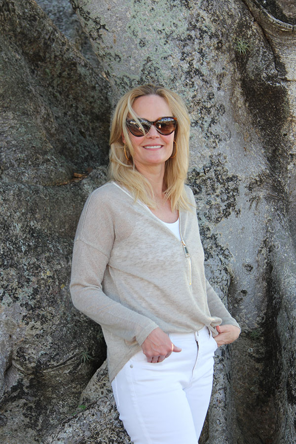 Ridgely Brode wears her new favorite white jeans with a zip sweater while on vacation on her blog Ridgely's Radar and shares other favorite tops.