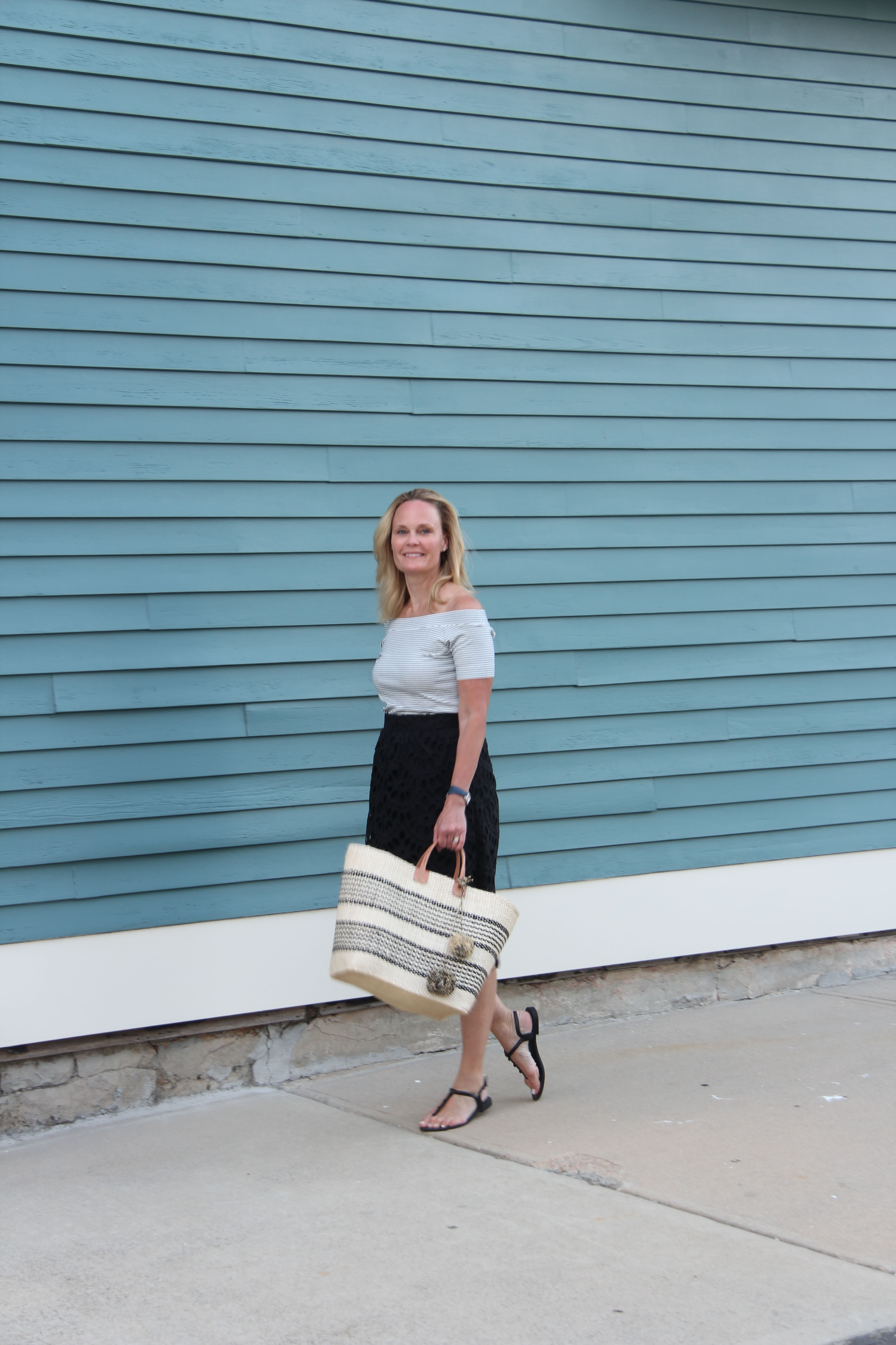 Ridgely Brode picked up this scalloped black lace skirt recently and paired it with a off the shoulder striped t-shirt on her blog, Ridgely's Radar.