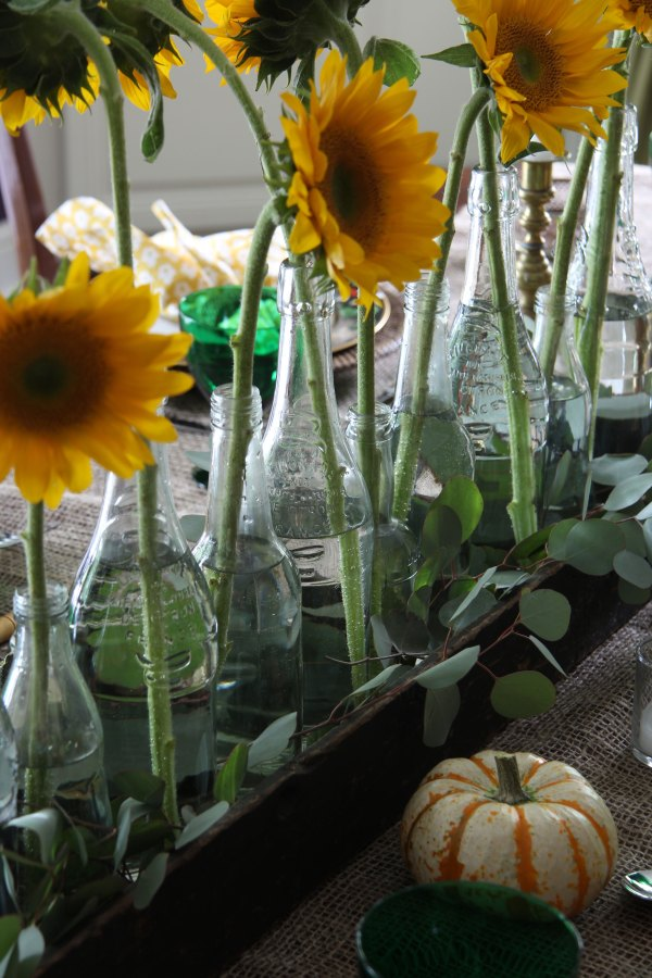 Ridgely Brode is setting a Fall table with grocery store flowers that is both inexpensive and easy to do on her blog Ridgely's Radar.