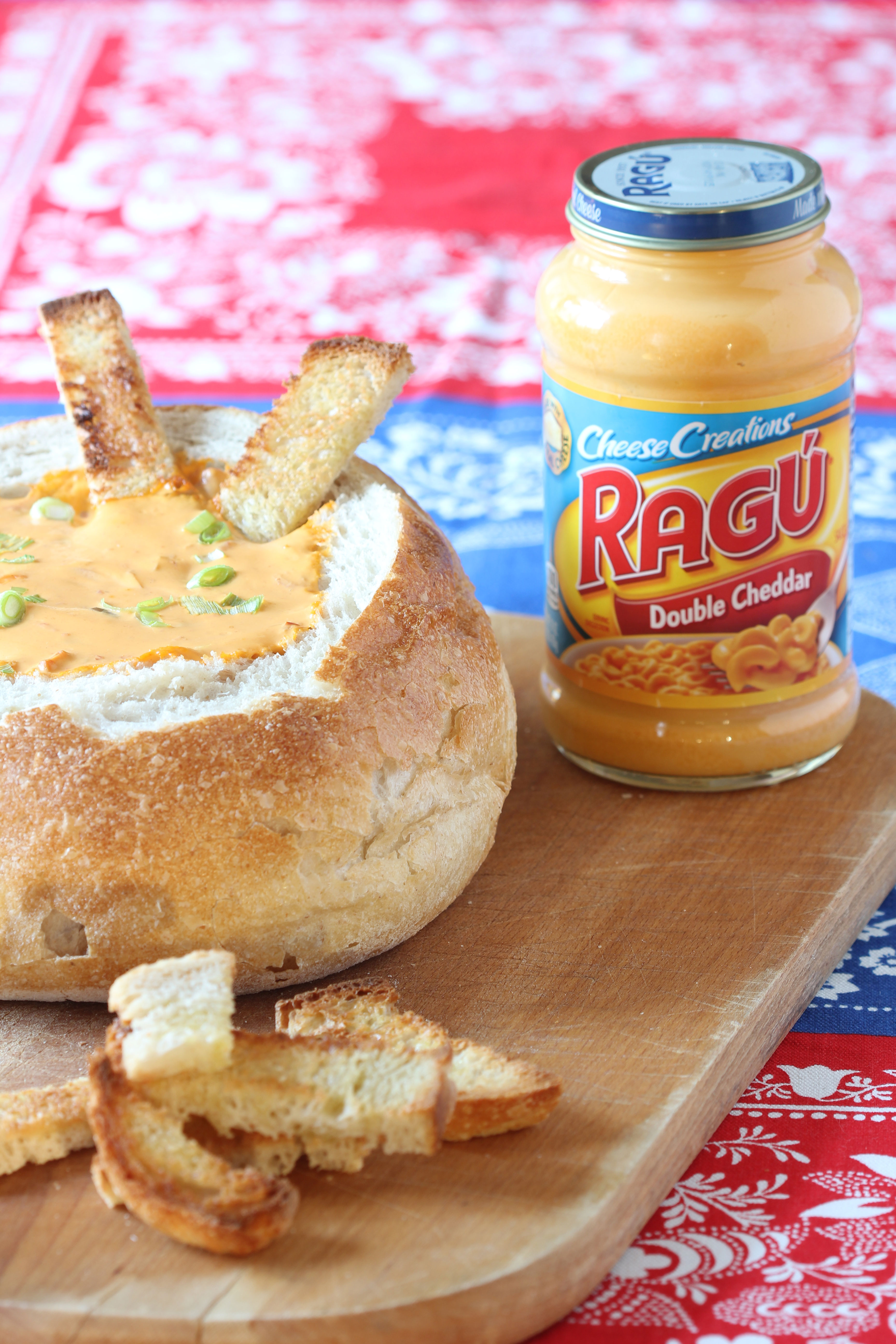 Ridgely Brode is serving up the best appetizer for game day that features RAGU Double Cheddar Cheese Sauce on her blog, Ridgely's Radar.