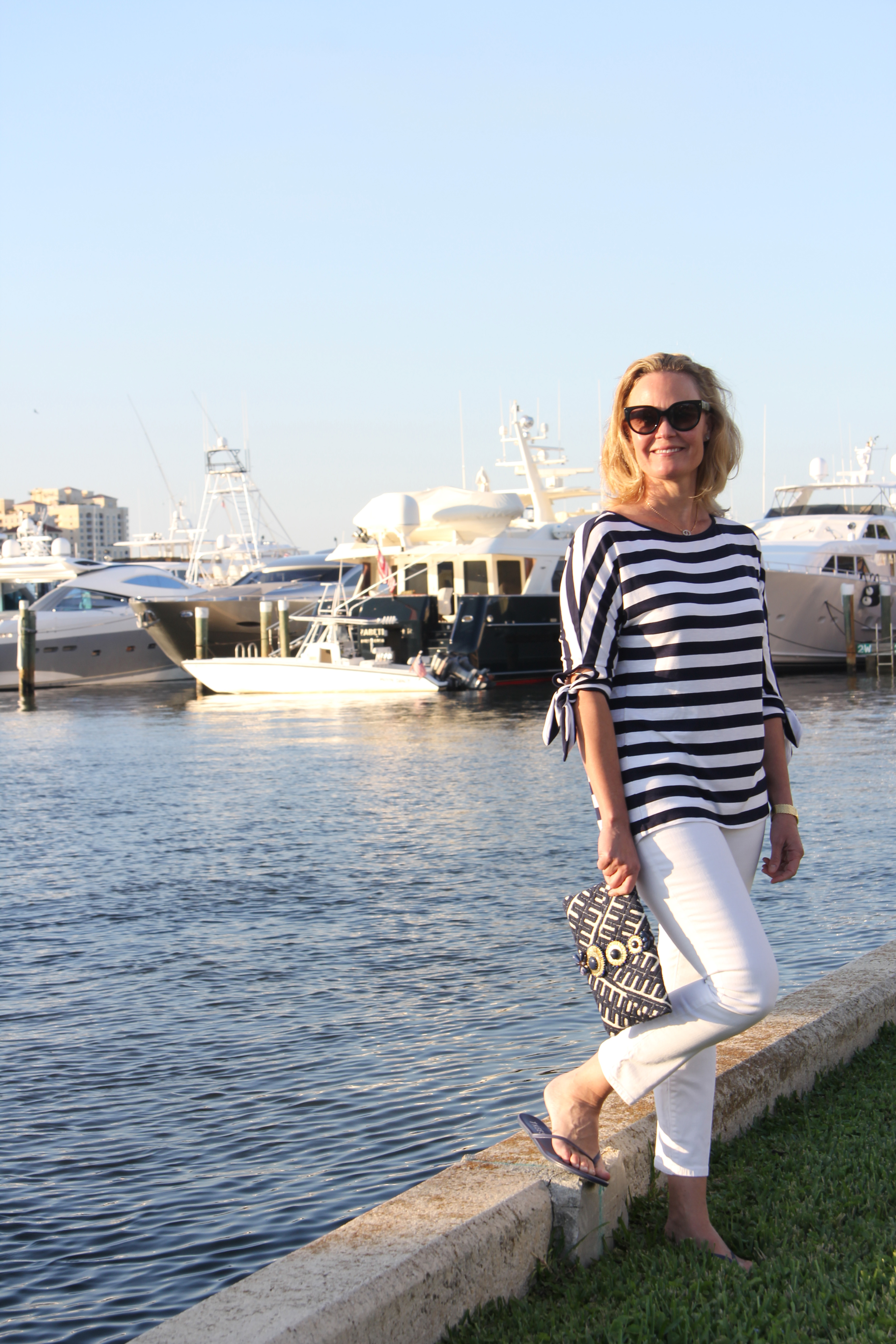 Ridgely Brode is sporting a comfortable and classic navy and white striped tie top while on vacation on her blog, Ridgely's Radar.