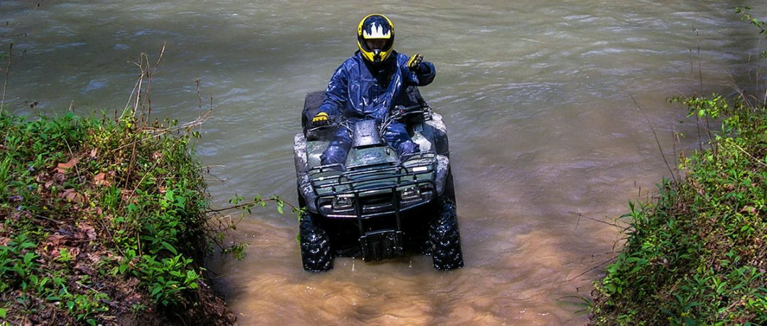 ATV rider crossing the river