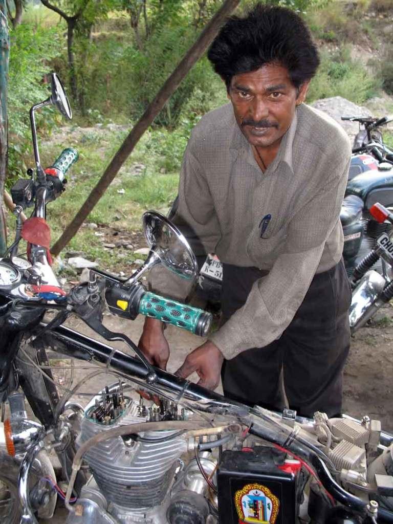 Mechanic-working-on-bike