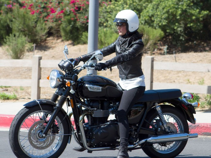 Leather clad Olivia Munn takes a spin on her motorbike in Malibu, CA.