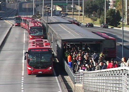 Bogota's efficient BRT with wide 3-lane roads and passenger overbridges