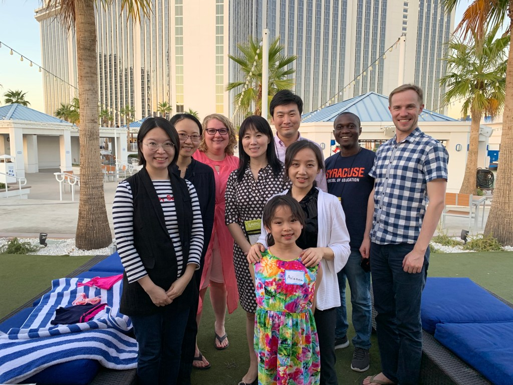 """IDD&E current and former students at the 2019 AECT Convention in Las Vegas, Nevada, on October 23, 2019. Back row, from left: Jiaming Cheng '19, Amber Walton, Jing Lei (IDD&E Department Chair), Heng """"Patrick"""" Luo '16, D. Garmondyu Whorway, and Yuri Pavlov. Front row, from left: Ye Chen '18, Lili Zhang, and Ariana Wang (Jing Lei's daughter)."""