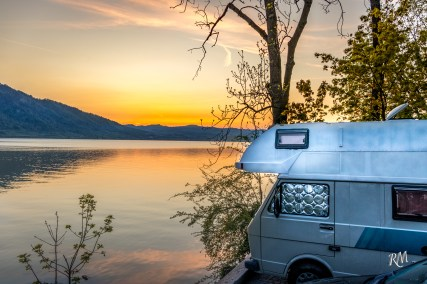 Sunset by the lake with our home on wheels