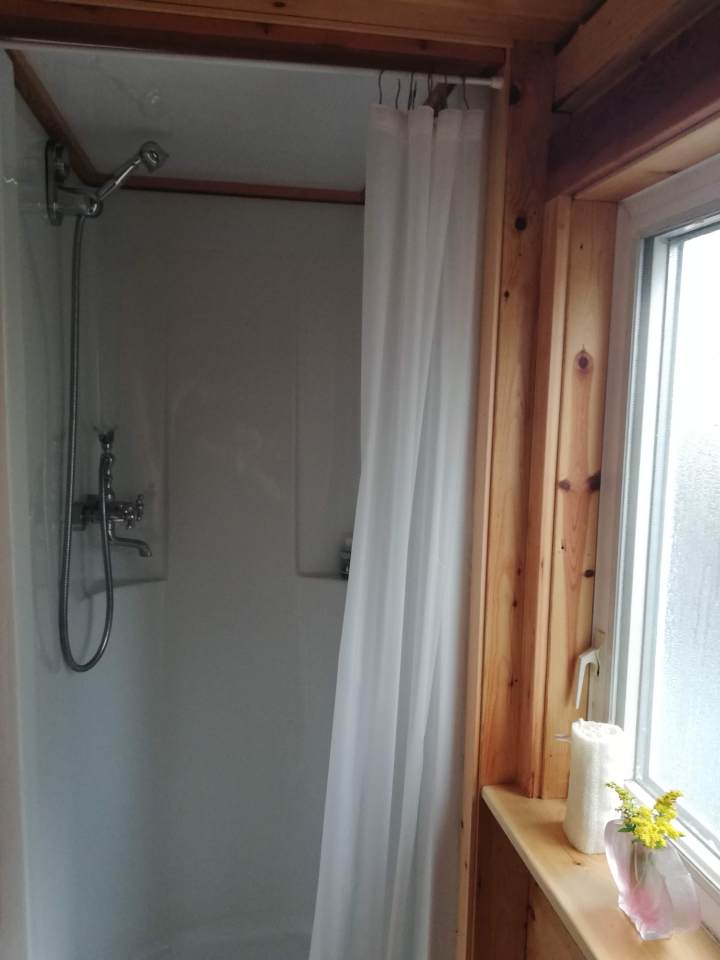 tiny house bathroom with full size shower
